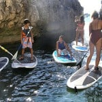 Visitig a grotto during SUP tour along Cascais coastline