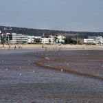 small waves in essaouira bay beach