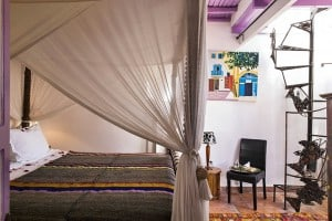 room 7 essaouira riad double bed bedroom with spiral staircase